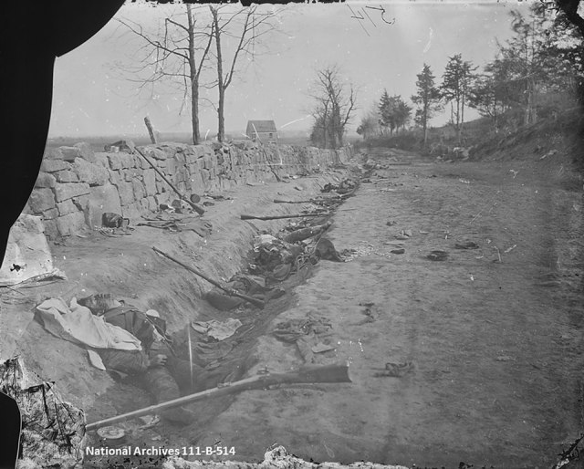 Andrew J. Russell photograph titled 'Stone wall, Rear of Fredericksburg with Rebel Dead'
