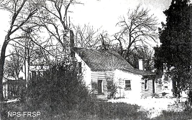 Photo of rear of the Ebert house in 1957. Note the small room with a shed roof added by Henry possibly in 1871.