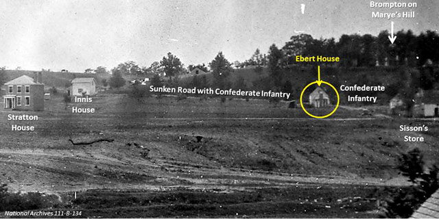 A cropped portion of 1864 photograph of Marye's Heights below Brompton. The Ebert house and barn are highlighted in yellow.